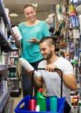 Man buying shampoo Royalty Free Stock Photography