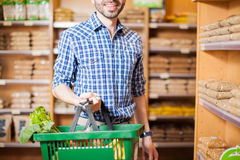 Man buying some groceries at a store Stock Images