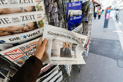 Man buying Suddeutsche Zeitung with the newly elected French pre Stock Image