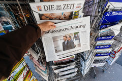 Man buying Suddeutsche Zeitung with the newly elected French pre Stock Photo