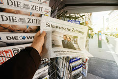 Man buying Suddeutsche Zeitung with the newly elected French pre Stock Images