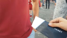 Man buying ticket for admission to event, illegal resale outdoors, counterfeit. Stock footage stock video footage