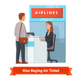 Man buying ticket for business trip at the airport Royalty Free Stock Photo