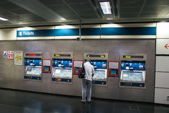 Man buying ticket in ticket machine at Boon Keng Station of Sing. Apore MRT Royalty Free Stock Photos