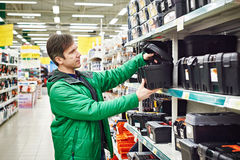 Man buying toolbox in store. Man buying toolbox in supermarket Stock Photography