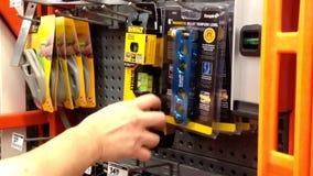 Man buying torpedo level stock footage