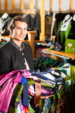 Man is buying Tracht or dirndl in a shop Royalty Free Stock Photo