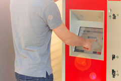 Man Buying Train Ticket Using Vending Machine At Station. Finger. Choice. Closed-up royalty free stock image