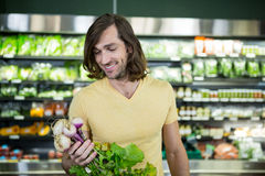 Man buying turnip in supermarket Stock Photos
