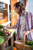 Man buying vegetables in organic shop Stock Photography