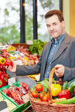Man buying vegetables Stock Photography