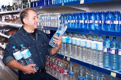 Man buying water at store Royalty Free Stock Images