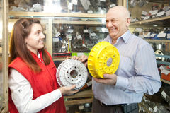 Man buys brake wheel in auto parts store Royalty Free Stock Photo