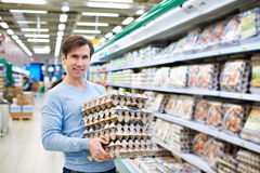 Man buys eggs in store Stock Image