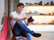 Man buys some shoes. Man buys some summer shoes at shop stock photography