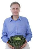 Man with cabbage Royalty Free Stock Photos