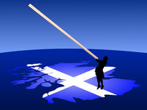 Man with caber on map Stock Photography