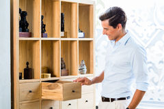 Man at cabinet in furniture store Royalty Free Stock Images