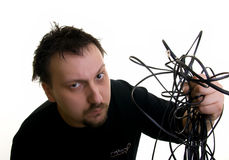 Man with cables. Man holding a pile of wires Stock Photos