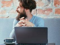 Man cafe laptop coffee cup blogging social media stock photo