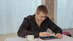 Man in a cafe with tablet stock footage