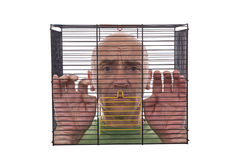 Man in cage Stock Photography
