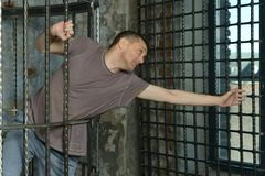 Man in cage Stock Images