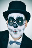 Man with calaveras makeup wearing eyeglasses and squinting Royalty Free Stock Images