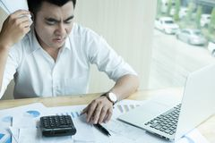 Man calculate domestic bills at home. Businessman using calculat Royalty Free Stock Images