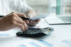 Man calculate domestic bills at home. Businessman using calculat Stock Photography