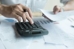 Man calculate domestic bills at home. Businessman using calculat Royalty Free Stock Photography