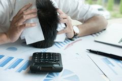 Man calculate domestic bills at home. Businessman using calculat Royalty Free Stock Photo