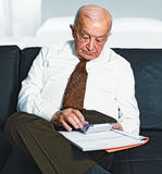 Man calculate his expenses Stock Image