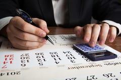Man calculates future plans Stock Image
