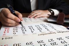 Man calculates future plans Stock Photos