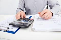 Man calculating bills Royalty Free Stock Images