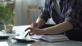 Man calculating expenses for utilities, planning family budget, credit payment