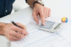 Man Calculating Finance. Closeup Of Man Calculating Financial Bills With Calculator stock images