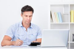 Man Calculating Finance Royalty Free Stock Image