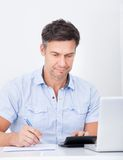 Man Calculating Finance Royalty Free Stock Photography