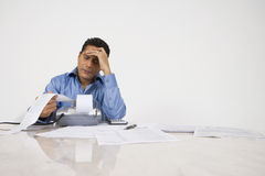Man Calculating Finances Stock Photo