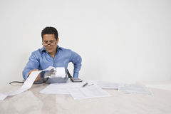 Man Calculating Finances Stock Photography