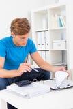 Man calculating his bills Stock Images