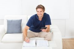 Man calculating home finances at table Royalty Free Stock Photo