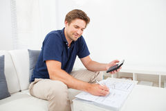 Man Calculating Home Finances At Table Stock Image
