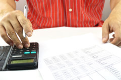 Man calculating interest rate of lottery for saving. Man are calculating the interest rate of the lottery for saving Royalty Free Stock Photo