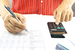 Man calculating interest rate of lottery. Man are calculating the interest rate of the lottery for saving Royalty Free Stock Image