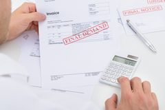 Man calculating invoice royalty free stock image