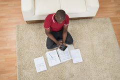 Man Calculating Invoices Using Calculator Stock Images
