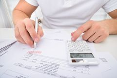 Man Calculating Past Due Statement. Using Calculator Royalty Free Stock Photography